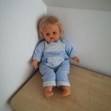 50 centis Cicciobello szőke hajú baba kék rugdalózóban