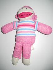 Rózsaszín zokni nyunya majom