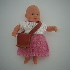Zapf puha törzsű csörgős baba kötött ruhácskában