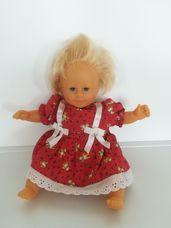 Corolle barna szemű szőke kislány baba piros ruhácskában