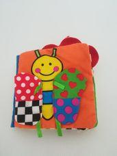 Libero színes textil zörgős babakönyv