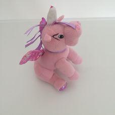Hátsó lábain ülő rózsaszín plüss csillámos sárkány