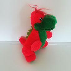 Piros színű plüss dinoszaurusz bébi zöld pocakkal