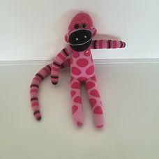 Csíkos hosszú farkú rózsaszín zokni nyunya majom