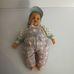 SIG puha törzsű kék szemű baba kockás rugiban