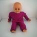 50 centis retro élethű csecsemő baba lila ruhában