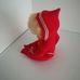 Szőke retro baba piros rugdalózóban