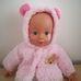 Csecsemő baba rózsaszín kabátkában