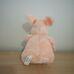 Rózsaszín színű vidám ábrázatú vigyorgó plüss malac