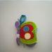 Bruin felakasztható csörgő pillangós babakönyv