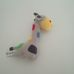 Early Days színes pöttyös csörgős plüss zsiráf