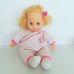 Szőke hajú puha testű kislány baba rózsaszín rugdalózóban