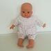 Interaktív Marca csecsemő baba zsebes rugdalózóban