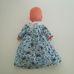 Simba kék szemű kopasz baba kék pillangós ruhában