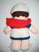 Nővérke ruhás barna hajú baba piros vállkendővel