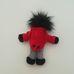 Golliwog piros frakkos csíkos nadrágos néger figura