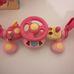 ELC zenélő világító felcsíptethető pink babakormány