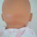 ELC Cupcake Lissi csecsemő baba rózsaszín rugdalózóban